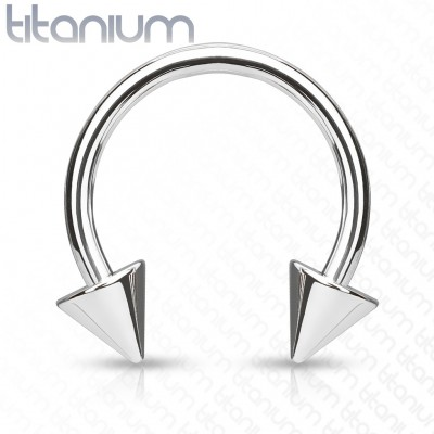 Solid titanium circular barbell with spikes