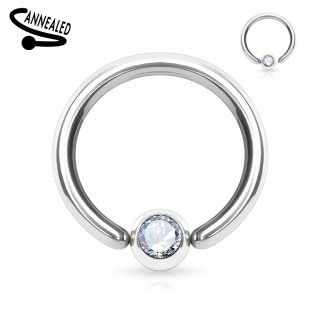 Ball closure ring with juweled ball attached