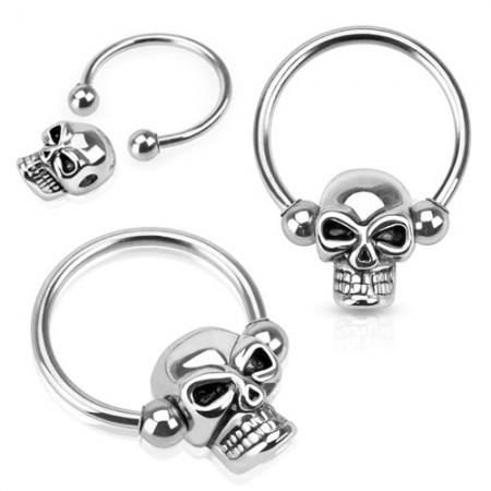 Ball closure ring met skull