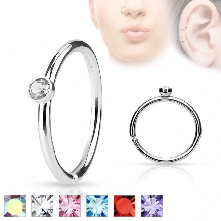 Piercing ring with small coloured gem