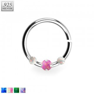 Piercing ring with 1 coloured and 2 white prong set opal stones