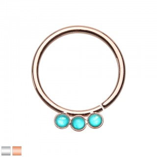 Coloured seamless ring with three cyan coloured stones