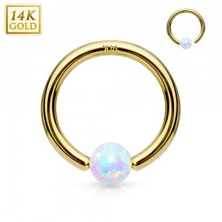 14K. massief gouden ball closure ring met vast Opaal balletje
