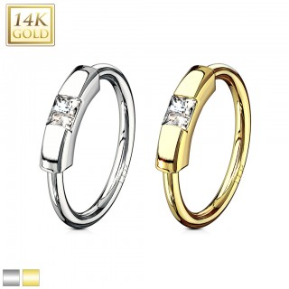 Solid gold segment ring with clear princess cut crystal