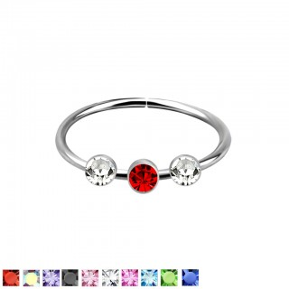 Piercing ring with 1 coloured and 2 clear crystals on top