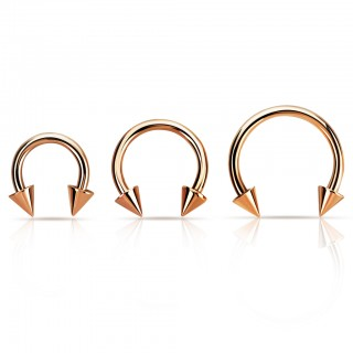 Rose gold plated circular barbell with spikes