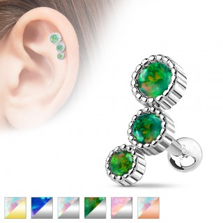 Cartilage piercing with three opal stones
