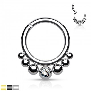 Piercing ring with attached segment and 7 beads and crystal