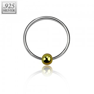 Sterling silver ball closure ring with gold fixed ball